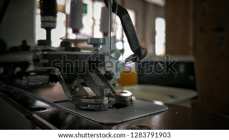 Buttoned machine For buttoning a shirt #1283791903