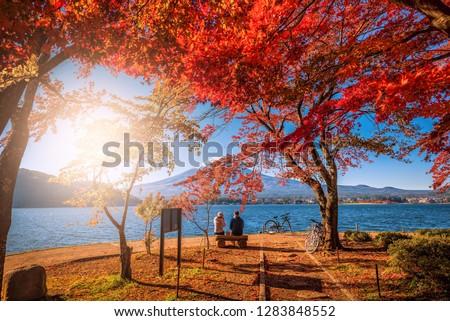 Mt. Fuji over Lake Kawaguchiko with autumn foliage and couple love at sunrise in Fujikawaguchiko, Japan. #1283848552