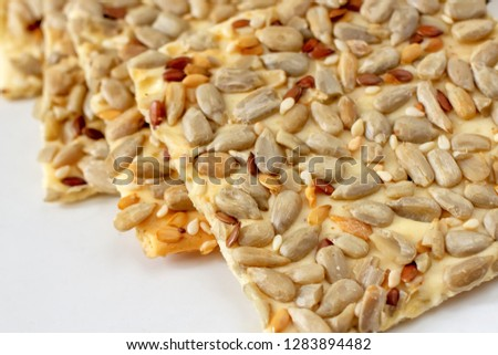 Wheat cracker with sunflower, sesame and flax seeds #1283894482
