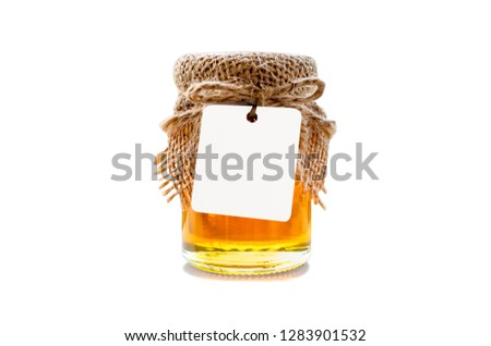 Wedding gift for the guest. Honey in a glass bottle for wedding gift with white tag ,isolate on white background. Wedding favors concepts. - Image. #1283901532