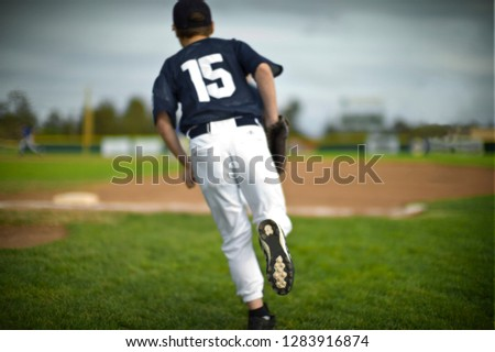 Baseball player running on field.