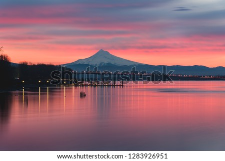 Colorful sunrise over Columbia River and Mt Hood #1283926951