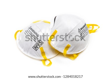 filtering face mask for covid-19 - protection factor for N95 - reduces wearer's exposure to particles including small particle aerosols and large droplets - safty mask on white background Royalty-Free Stock Photo #1284018217
