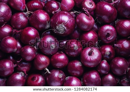 Full Frame Shot Of Purple Onions. Fresh purple onions as a background.  Royalty-Free Stock Photo #1284082174