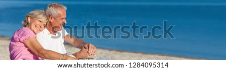 Panorama web banner happy romantic senior man and woman couple together on a deserted beach  #1284095314