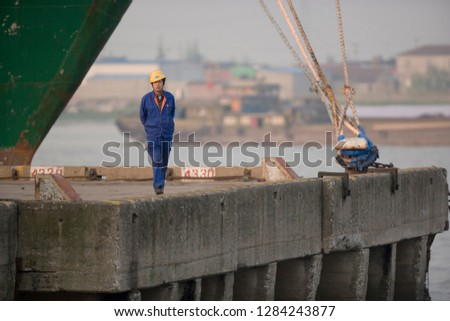 Portrait of a mid-adult man walking on a wharf. #1284243877