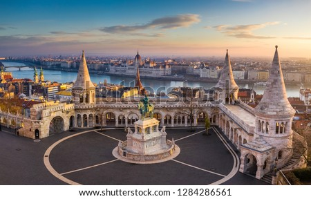 Budapest, Hungary - The famous Fisherman's Bastion at sunrise with statue of King Stephen I and Parliament of Hungary at background #1284286561