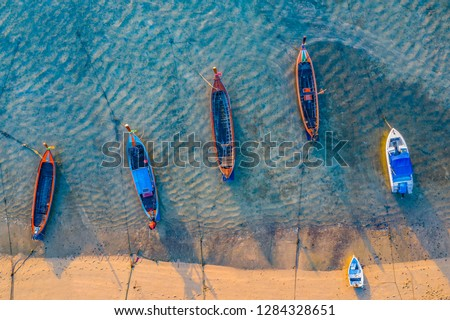 top view fishing boats in the shore during low tide at Rawai beach Phuket Thailand