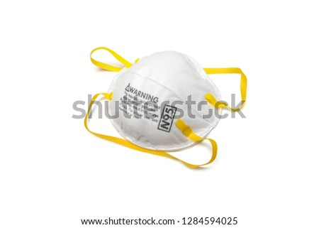 An N95 respirator is a respiratory protective device designed to achieve a very close facial fit and very efficient filtration of airborne particles, pm2.5, covid-19, corona virus. Royalty-Free Stock Photo #1284594025