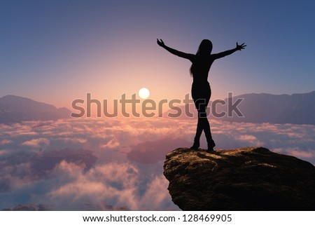 Silhouette of a woman on a rock. #128469905