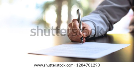 Businessman Signing An Official Document #1284701290