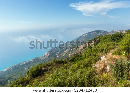 Misty summer hilly coast panorama (Greece, Lefkada). View from up. #1284712450