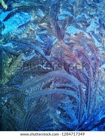Frost-frawn pattern on the window #1284717349