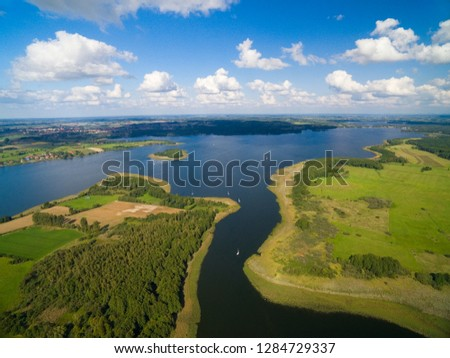 Aerial view of yachts sailing on Swiecajty Lake, Kal village (former Kehlen or Kielno, East Prussia), Mazury, Poland #1284729337
