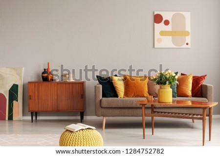 Retro design in trendy living room interior wooden furniture and comfortable couch #1284752782