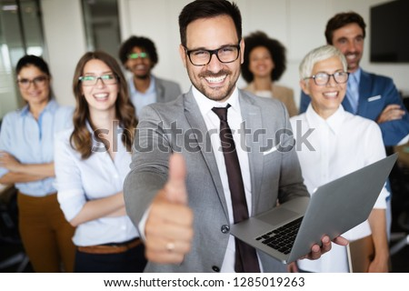 Business people working and brainstorming in office #1285019263