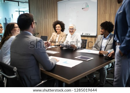 Group of successful business people at work in office #1285019644
