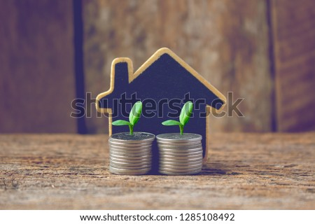 real estate investmen,image of house model with stack of coins #1285108492