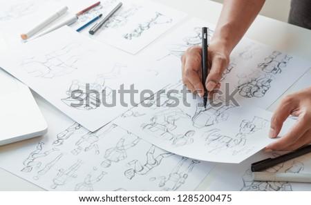 Animator designer Development designing drawing sketching development creating graphic pose characters sci-fi robot Cartoon illustration animation video game film production , animation design studio. #1285200475