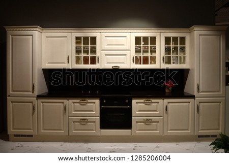 Beige kitchen set with stove in the room #1285206004