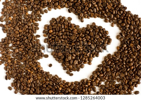 heart of many fresh coffee beans isolated view from above #1285264003
