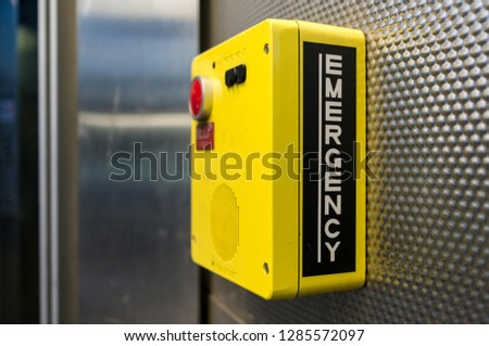 Yellow Emergency Box with Big Red Panic Button #1285572097