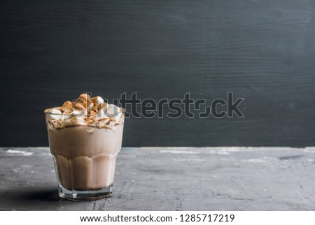 Hot Chocolate drink with marshmallow and cinnamon in old-fashioned glass. Selective focus. #1285717219