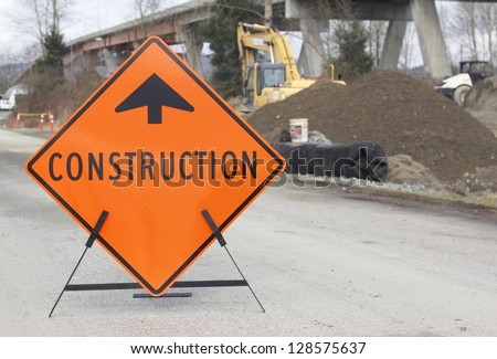 A sign points motorists to nearby bridge construction/Bridge Construction Sign/A construction sign is placed near construction work on a bridge to notify on-coming motorists.