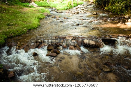 The stream that flows from Chae Son Waterfall Chiangmai Province #1285778689