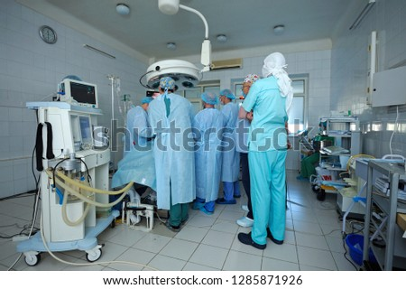 At the operating theatre. Surgeons standing around patient plate and performing an operation. January 12, 2019. Kiev regional clinic 1. Kiev, Ukraine #1285871926