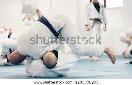 jiu-jitsu exercise training for martial art practice instructor doing workout for brazilian traditional jiu jitsu technique #1285908205