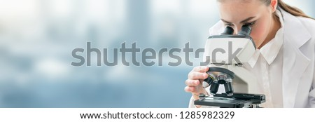 Scientist researcher using microscope in laboratory. Medical healthcare technology and pharmaceutical research and development concept. #1285982329