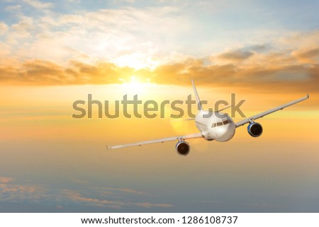 Flying and traveling, sunset sun glare in the evening voyage airplane. #1286108737