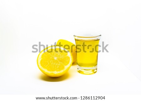 A Mexican tequila shot with lemon on a white isolated background #1286112904