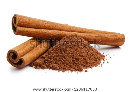 Cinnamon sticks and powder, isolated on white background Royalty-Free Stock Photo #1286117050