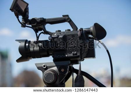 Professional digital video camera shoots video outdoors. #1286147443