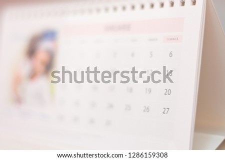 Blurred calendar abstract, background close-up image #1286159308