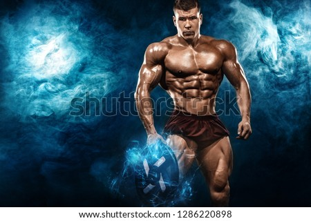 Brutal strong muscular bodybuilder athletic man pumping up muscles with barbell on black background. Workout bodybuilding concept. Copy space for sport nutrition ads. #1286220898