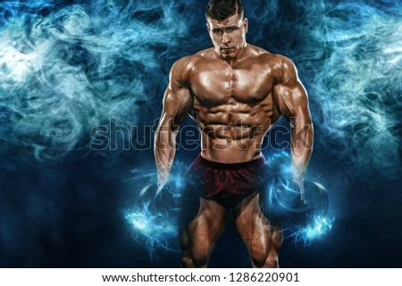 Brutal strong muscular bodybuilder athletic man pumping up muscles with dumbbell on black background. Workout bodybuilding concept. Copy space for sport nutrition ads. #1286220901