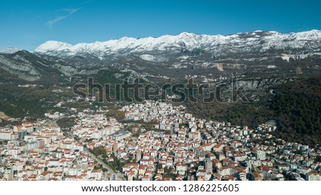 Aerial View of winter Budva, the old town in Montenegro and snow-capped mountains #1286225605