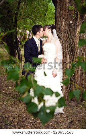 Happy young bride and groom on their wedding day. Wedding couple - new family! wedding dress. Bridal wedding bouquet of flowers #128635163