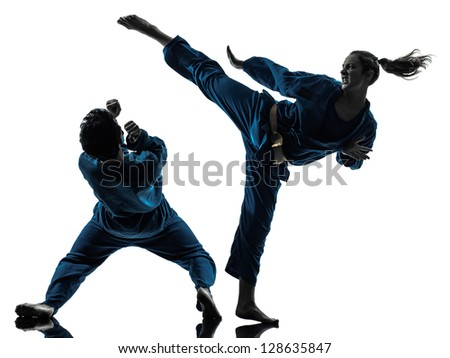 one  man woman couple exercising karate vietvodao martial arts in silhouette studio isolated on white background Royalty-Free Stock Photo #128635847