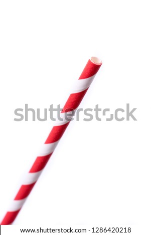 Very closeup of drinking straw for party.  Red spiral. Top view of colorful disposable eco-friendly straw for summer cocktails. Paper coctail colorful straw isolated on white  background, isolated. #1286420218