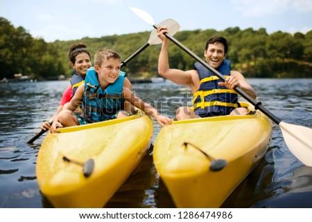 Happy family kayaking on a lake. #1286474986