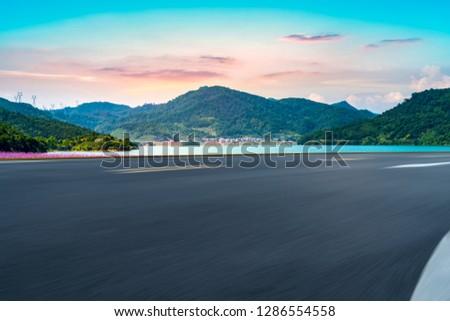 Highway Asphalt Pavement and Natural Landscape #1286554558