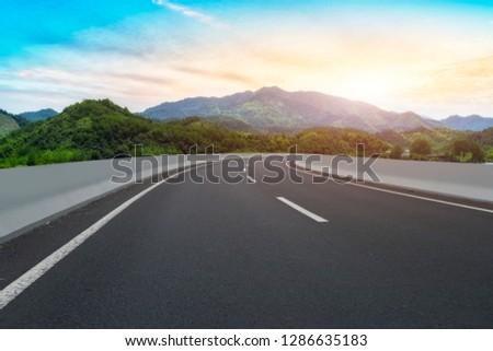 Highway Asphalt Pavement and Natural Landscape #1286635183