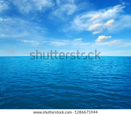 Blue sea water surface on sky #1286675944