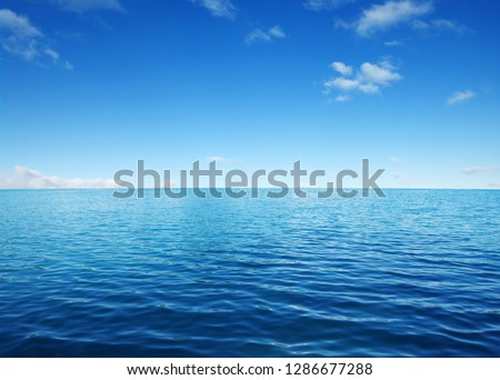 Blue sea water surface on sky #1286677288