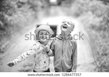 Portrait of joyful children. Happy Boy and Girl. B W photo #1286677357