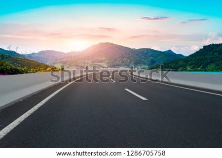 Highway Asphalt Pavement and Natural Landscape #1286705758